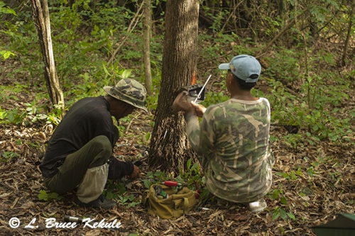 rangers-setting-a-camera-trap