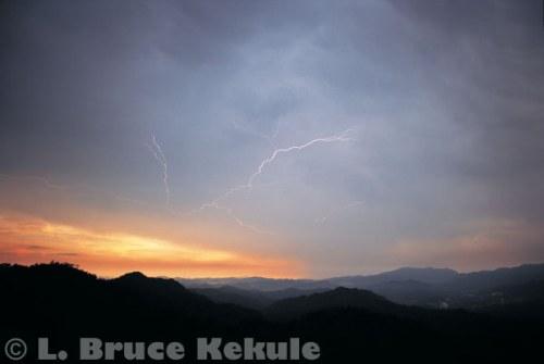 Lightning and sunset over the Phetchaburi River