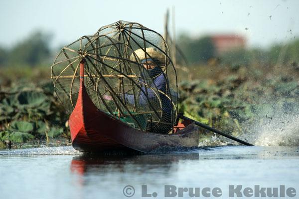 Boat with fish traps in Beung Boraphet